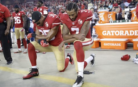 Why Are Football Players Kneeling?