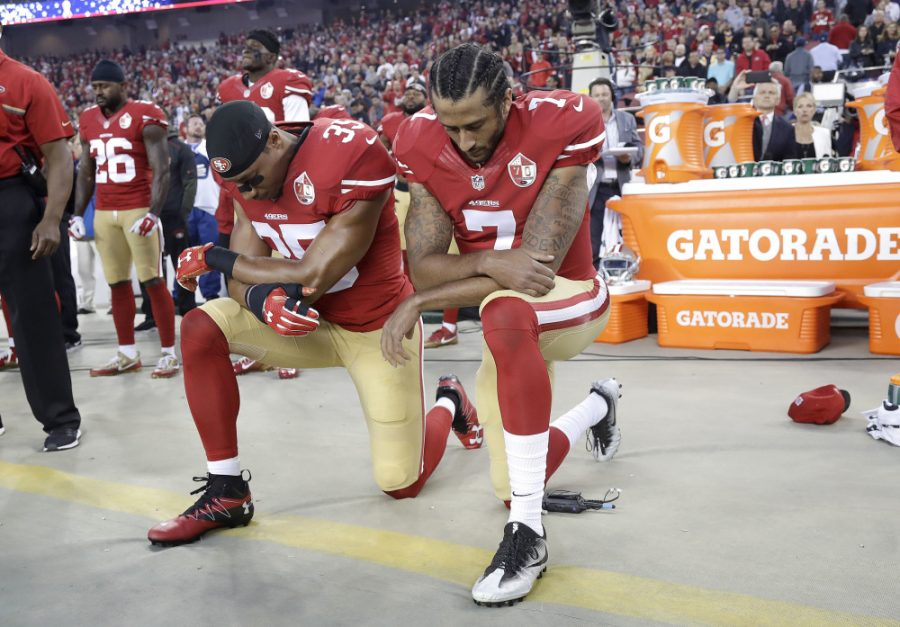 San Francisco 49ers safety Eric Reid (35) and quarterback Colin Kaepernick (7) kneel during the national anthem before an NFL football game against the Los Angeles Rams in Santa Clara, Calif., Monday, Sept. 12, 2016. (AP Photo/Marcio Jose Sanchez) ORG XMIT: FXN102